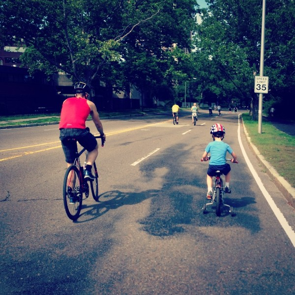 Bryan and child riding a bike 2
