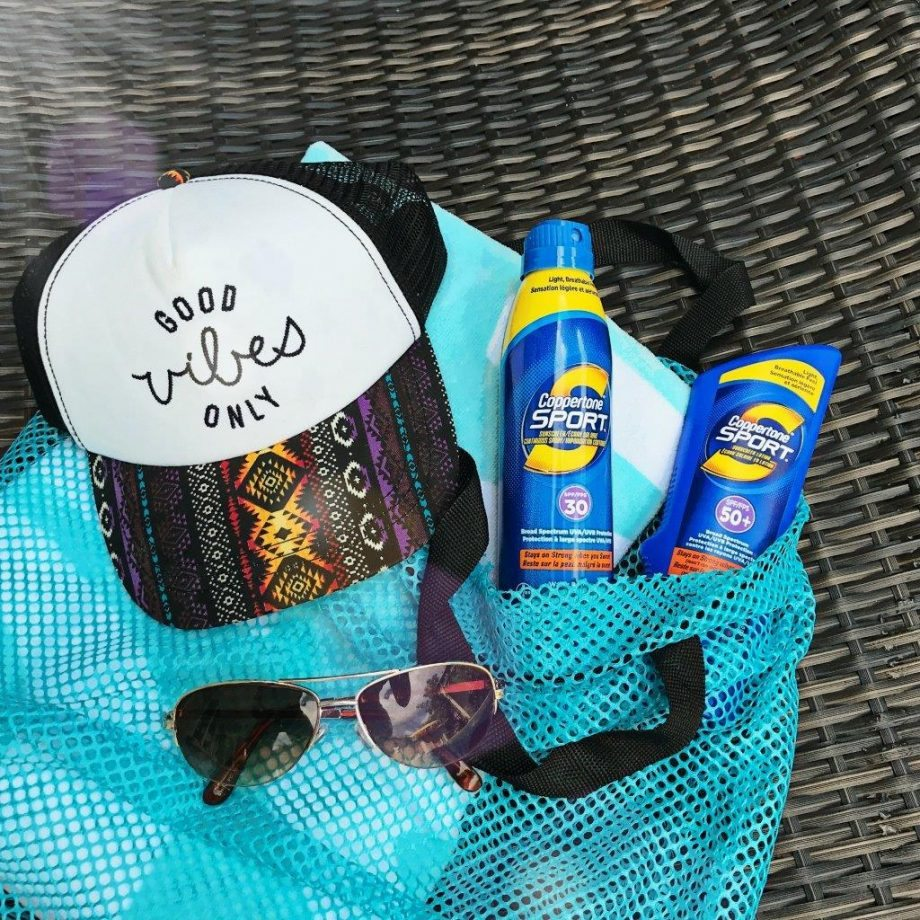 The perfect beach pack: Sunglasses, hat, and sunscreen... need I say more?