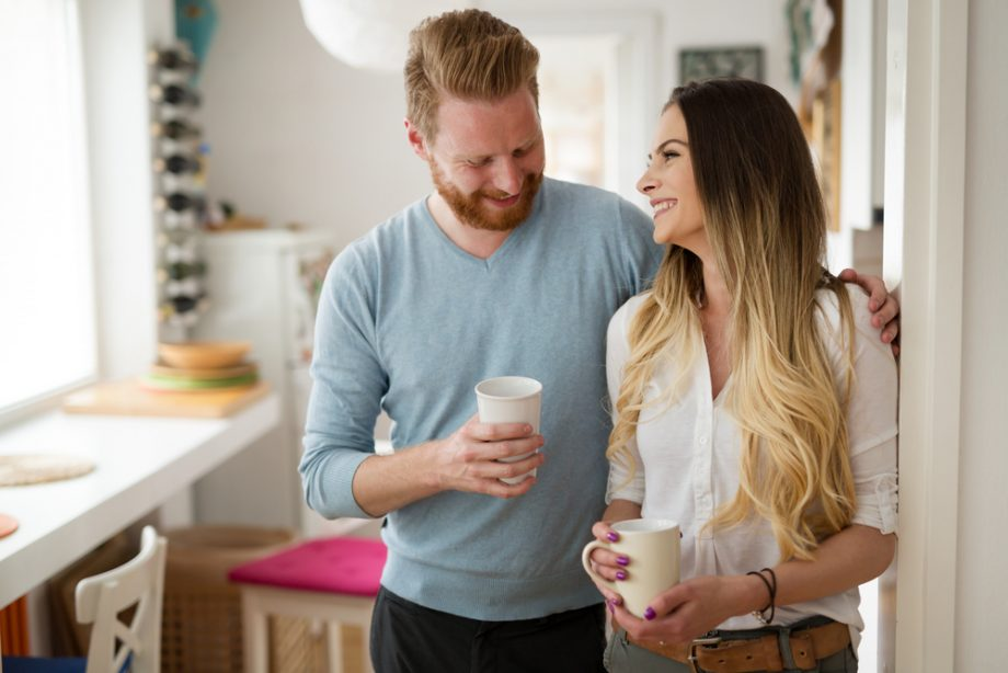 Romantic couple in love at home drinking coffee