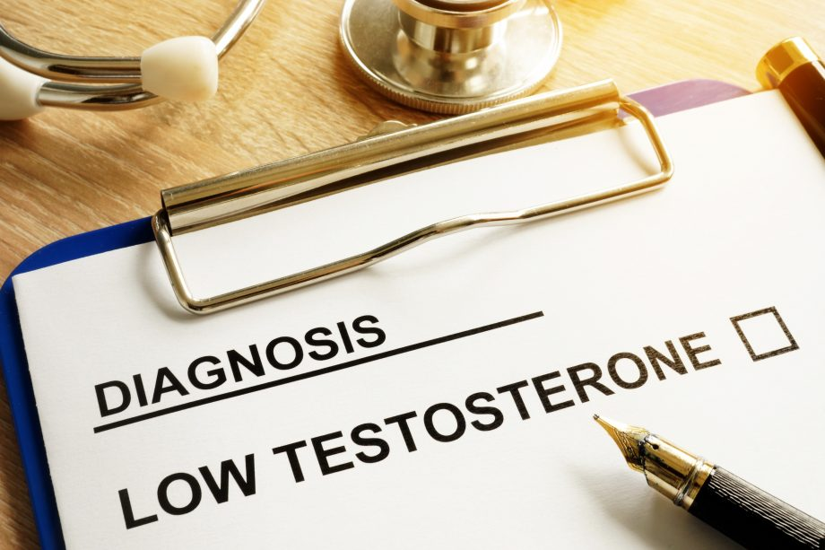 Diagnosis Low testosterone and pen on a desk.